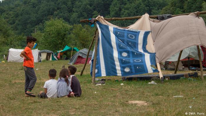 Children near makeshift tents on the Balkan route in Velika Kladusa, Bosnia and Herzegovina