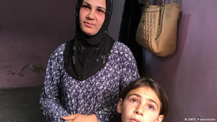 Returnee Zahra with one of her children