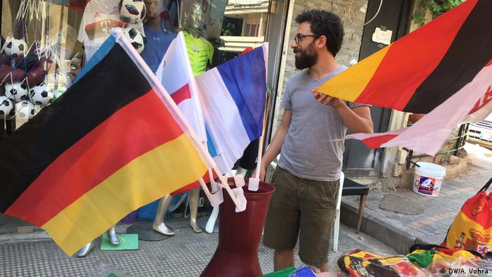 FIFA 2018 World Cup: A football fan in Beirut buying a flag of his favorite team at a street kiosk (DW/A. Vohra)