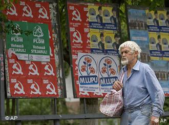 Man walks past election posters in Moldova