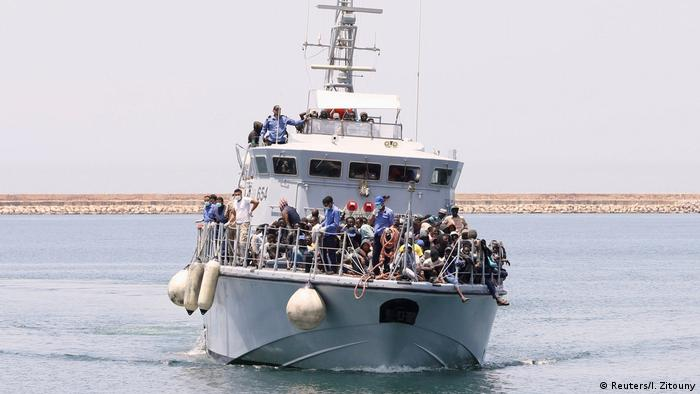 Migrants on a Libyan Navy boat