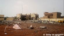 29.06.2018 +++ A picture taken in Sevare in central Mali, on June 29, 2018 shows debris scattered in front of the head quarter of the anti-terror task force, the G5 Sahel, after an attack of a suicide bomber who tried to penetrate the base. - The Malian headquarters of an anti-terror task force, the G5 Sahel, came under attack on June 29, 2018, killing six people and leaving many injured, according to a provisional toll. (Photo by STRINGER / AFP) (Photo credit should read STRINGER/AFP/Getty Images)