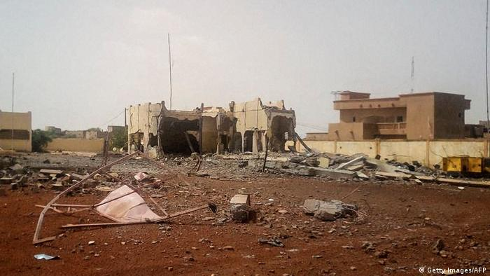 The scene in the aftermath of the bombing of the G5 Sahel headquarters. A bulding at the centre of the image is completely destroyed.