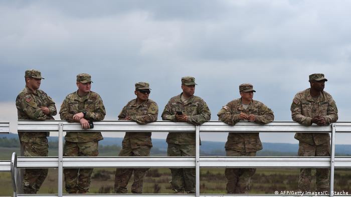 US soldiers stand at a visitor platform during the friendship shooting of the exercise 'Strong Europe Tank Challenge 2017' at the exercise area in Grafenwoehr, near Eschenbach, southern Germany, on May 12, 2017. (AFP/Getty Images/C. Stache)