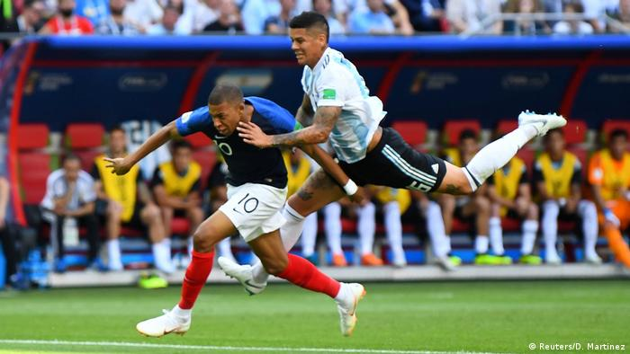 Kylian Mbappe is brought down by Marcos Rojo (Reuters/D. Martinez)
