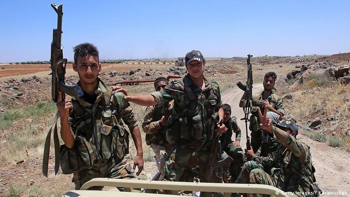 Soldiers in Syria holding guns