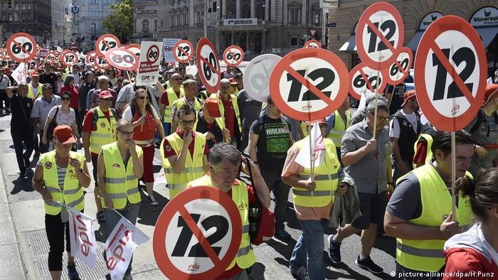 Demostrators walk through Vienna, protesting plans to extend the work day in Austria to 12 hours