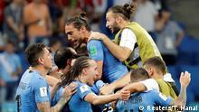 Soccer Football - World Cup - Round of 16 - Uruguay vs Portugal - Fisht Stadium, Sochi, Russia - June 30, 2018 Uruguay's Martin Caceres, Jose Gimenez and team mates celebrate at the end of the match REUTERS/Toru Hanai