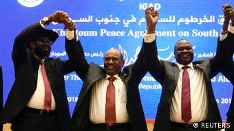 Salva Kiir, Sudan's Omar Al-Bashir and Riek Machar jointly raise their hands in celebration of the peace deal (REUTERS)