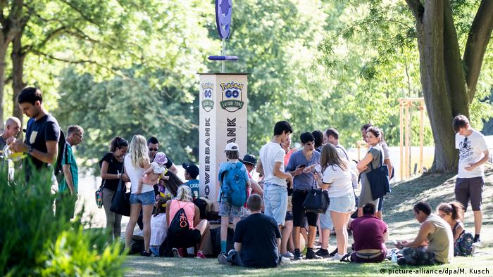 Young people gather outside in Dortmund for a Pokemon Go Safari