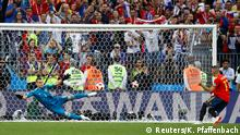 Soccer Football - World Cup - Round of 16 - Spain vs Russia - Luzhniki Stadium, Moscow, Russia - July 1, 2018 Russia's Igor Akinfeev saves a penalty from Spain's Iago Aspas during the shootout REUTERS/Kai Pfaffenbach