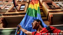 A LGBT rights activist shouts slogans during a march on July 1, 2018 in Istanbul, after Turkish authorities banned the annual Gay Pride Parade for a fourth year in a row. - Around 1,000 people gathered on a street near Istiklal Avenue and Taksim Square where organisers wanted to originally hold the parade, an AFP photographer said. Police warned activists to disperse but used rubber bullets against some who tried to access Istiklal Avenue. (Photo by BULENT KILIC / AFP) (Photo credit should read BULENT KILIC/AFP/Getty Images)