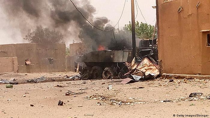 Smoke and flames rise from an armored vehicle in Gao, northwestern Mali, following an explosion