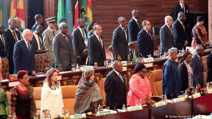 African heads of government standing at the opening of the AU summit.