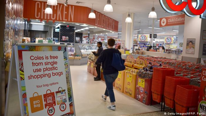 A sign in a Coles supermarket advises its customers of its plastic bag free (Getty)