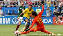 02.07.2018 +++ Soccer Football - World Cup - Round of 16 - Brazil vs Mexico - Samara Arena, Samara, Russia - July 2, 2018 Mexico's Guillermo Ochoa makes a save from Brazil's Neymar before Roberto Firmino (not pictured) scores Brazil's second goal REUTERS/Carlos Garcia Rawlins