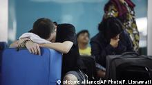 Tourists rest as Ngurah Rai International Airport is closed due to the eruption of Mount Agung in Bali, Indonesia Friday, June 29, 2018. The Indonesian tourist island of Bali closed its international airport Friday, stranding thousands of travelers, as the Mount Agung volcano gushed a 2,500-meter (8,200-feet) column of ash and smoke. (AP Photo/Firdia Lisnawati) |