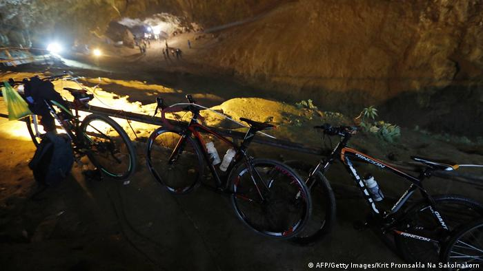 The boys' bikes lean against a fence outside the Thai cave where they went missing (AFP/Getty Images/Krit Promsakla Na Sakolnakorn)