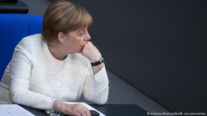 Chancellor Angela Merkel sits in Germany's parliament, the Bundestag