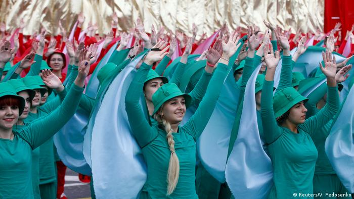 Belarusian women perform after a military parade marking Belarus' Independence Day in Minsk on July 3