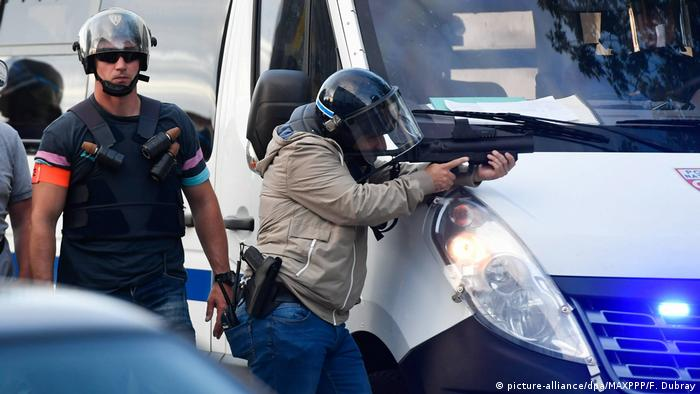 French police and protesters clash after officer shoots dead young driver