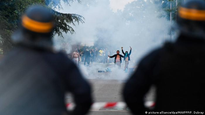 Protesters in Nantes gesture to police during clashes