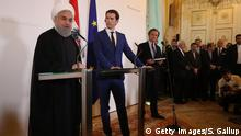 04.07.2018 *** VIENNA, AUSTRIA - JULY 04: Austrian Chancellor Sebastian Kurz and Iranian President Hassan Rouhani speak to the media following talks at the Federal Chancellery on July 4, 2018 in Vienna, Austria. Rouhani is on a one-day visit to Austria, during which he is meeting with President van der Bellen and Chancellor Kurz and will attend an event at the Austrian Chamber of Commerce. (Photo by Sean Gallup/Getty Images)