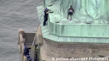 04.07.2018 +++ In this image made from video by PIX11, a person, center, leans against the robes of the Statue of Liberty on Liberty Island, as one of the police officers climbed up on a ladder to stand on a ledge nearby talking the climber into descending in New York, Wednesday, July 4, 2018. (PIX11 via AP) |