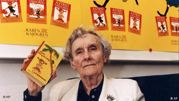 Swedish Author Astrid Lindgren holds a copy of a Pippi Longstocking book.