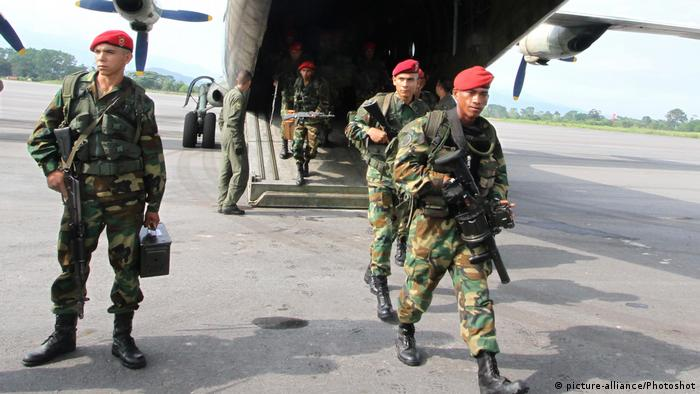 Members of Venezuela's Air Force exit an aircraft