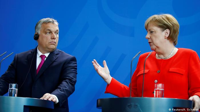 Viktor Orban and Angela Merkel