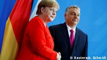German Chancellor Angela Merkel shaking hands with Hungarian Prime Minister Viktor Orban in Berlin