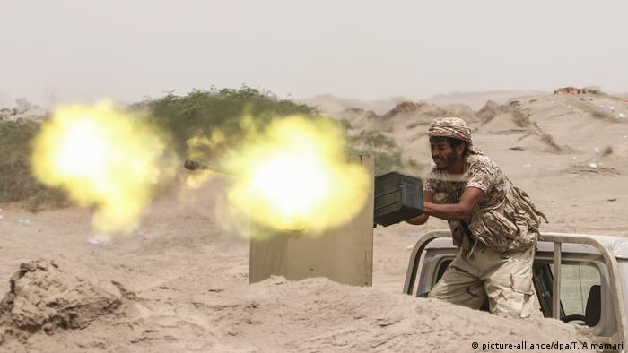 A soldier firing his weapon near Hedeida in western Yemen