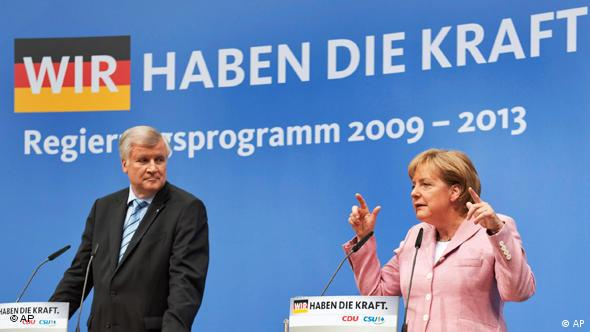 Chancellor Angela Merkel and Horst Seehofer at a rally of the conservatives in June