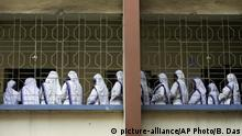 FILE- In this April 27, 2011 file photo, nuns of Missionaries of Charity, the order founded by Mother Teresa, stand in a queue to cast their vote during West Bengal state assembly elections in Kolkata, India. Police in eastern India say they have arrested a nun and another worker at a shelter run by Mother Teresa's charity for allegedly selling a baby. (AP Photo/Bikas Das, File)  
