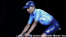 Colombia's Nairo Quintana rides onto the podium during the Tour de France cycling race team presentation in La Roche-sur-Yon, Vendee region, France, Thursday, July 5, 2018, ahead of upcoming Saturday's start of the race. (AP Photo/Christophe Ena ) |