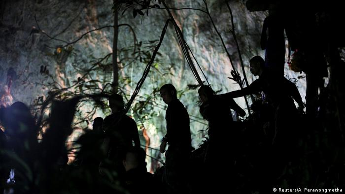 Military personnel in front of the Tham Luang cave, Chiang Rai, Thailand (Reuters/A. Perawongmetha)