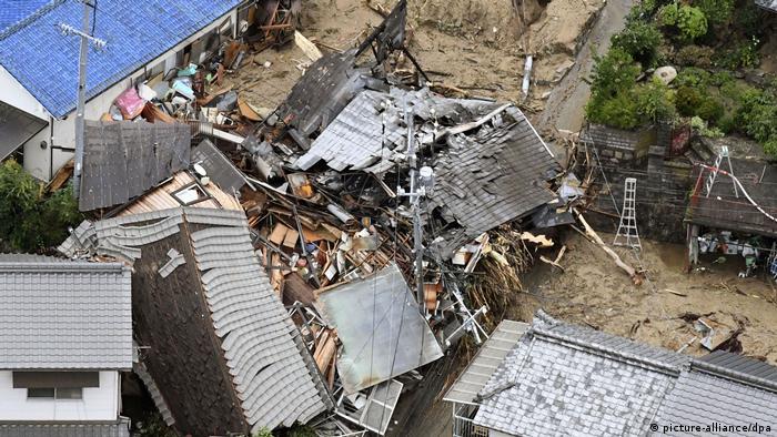 Buildings lie in ruins after being struck by a massive landslide.