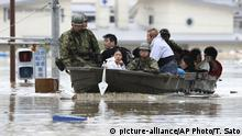 Japan Ground Self-Defense Force members use a boat to evacuate residents from a flooded area caused by heavy rains in Kurashiki, Okayama prefecture, southwestern Japan, Saturday, July 7, 2018. Torrents of rainfall and flooding continued to batter southwestern Japan. (Takumi Sato/Kyodo News via AP) |