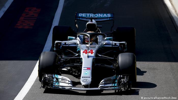 A Formula 1 racing car with the Petronas logo