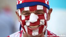 SOCHI, RUSSIA - JULY 7, 2018: Croatia s fan with his face painted in the colours of the Croatian national flag seen outside Fisht Stadium ahead of the 2018 FIFA World Cup WM Weltmeisterschaft Fussball Quarterfinal match between Russia and Croatia. Valery Sharifulin/TASS PUBLICATIONxINxGERxAUTxONLY TS088793