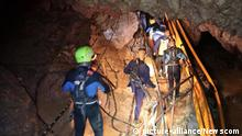 Members of the Royal Thai Navy along with volunteers from England, the United States, Australia, and China, are pictured as they prepare to rescue 12 schoolboys, members of a local soccer team, and their coach, from the Tham Luang Cave network in Northern Thailand. Two British volunteer divers found the missing boys Monday after a nine-day search. Photo by Royal Thai Navy/UPI Photo via Newscom picture alliance |