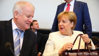 Merkel and Seehofer (Reuters/H. Hanschke)