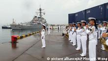 FILE - In this Aug. 8, 2016 file photo, a Chinese military band plays as the guided missile destroyer USS Benfold arrives in port in Qingdao in eastern China's Shandong Province in the first visit by an American warship to the country since Beijing responded angrily to an arbitration panel's ruling that its expansive South China Sea maritime claims had no basis in law. A senior Chinese diplomat made clear Monday, Aug. 15, that Beijing wants next month's meeting of leaders of the Group of 20 major economies to avoid political issues such as its territorial disputes with its neighbors in the South China Sea. (AP Photo/Borg Wong, File) |