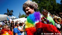 A reveller takes part in the annual Christopher Street Day gay pride parade in Cologne, Germany