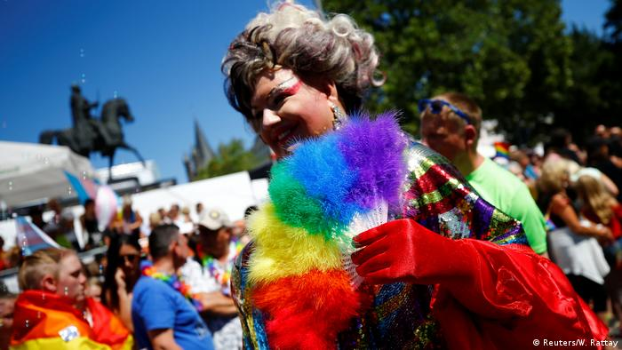 A reveller takes part in the annual pride parade in Cologne.