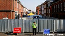 08.07.2018 FILE PHOTO: A police officer stands in front of screening erected behind John Baker House, after it was confirmed that two people had been poisoned with the nerve-agent Novichok, in Amesbury, Britain, July 5, 2018. REUTERS/Henry Nicholls/File Photo