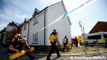 08.07.2018 FILE PHOTO: Fire and Rescue Service personel arrive with safety equipment at the site of a housing estate on Muggleton Road, after it was confirmed that two people had been poisoned with the nerve-agent Novichok, in Amesbury, Britain, July 6, 2018. REUTERS/Henry Nicholls/File Photo
