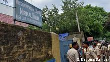 Police stand outside a Missionaries of Charity shelter