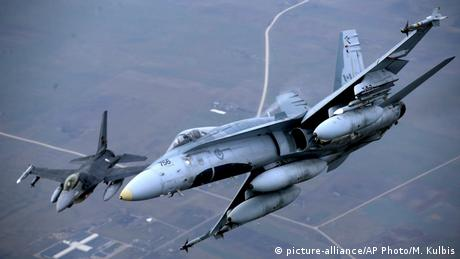 Fighter jets from Portugal and Canada take part in a policing mission in Lithuanian airspace